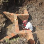 The Water Project: Emmachembe Community, Magina Spring -  Pipe Setting
