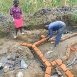 The Water Project: Sichinji Community, Kubai Spring -  Bricklaying On The Foundation