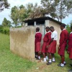 The Water Project: Friends School Ikoli Secondary -  Girls Queue To Use Latrines