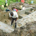 The Water Project: Bung'onye Community, Shilangu Spring -  Plastering Rub Walls
