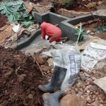 The Water Project: Hirumbi Community, Khalembi Spring -  Tile Setting