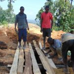 The Water Project: Musasa Primary School -  Fitting Lumber Over Latrine Pits