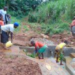 The Water Project: Mushina Community, Shikuku Spring -  Cleaning Demonstration