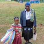 The Water Project: Kapsaoi Primary School -  Deputy Head Teacher Mrs Josephine Awinja With A Pupil