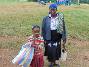 The Water Project:  Deputy Head Teacher Mrs Josephine Awinja With A Pupil