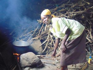 The Water Project:  School Cook Joyce Kageha At The Kitchen Fireplace