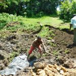 The Water Project: Bung'onye Community, Shilangu Spring -  Soil Backfilling