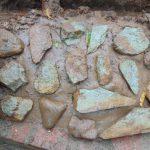 The Water Project: Shamakhokho Community, Imbai Spring -  Rub Wall Construction