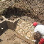 The Water Project: Emmachembe Community, Magina Spring -  Rub Wall Construction