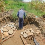 The Water Project: Sichinji Community, Kubai Spring -  Stone Pitching