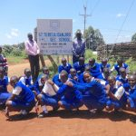 The Water Project: St. Teresa's Isanjiro Girls Secondary School -  Students Pose With School Sign