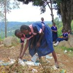 The Water Project: Kapkoi Primary School -  Students Picking Up Rubbish