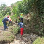 The Water Project: Chegulo Community, Sembeya Spring -  Backfilling With Stones