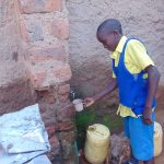 The Water Project: Saride Primary School -  Student Collecting Water