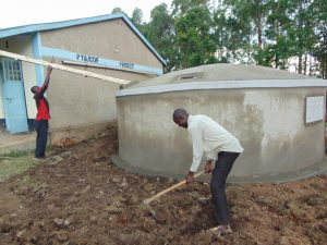 The Water Project:  Attaching The Gutter And Clearing The Ground