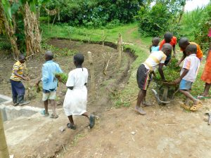 The Water Project:  Kids Help Deliver And Plant Grass