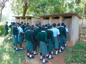 The Water Project:  Girls Queueing To Use Latrines