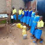 The Water Project: Saride Primary School -  Students Collecting Water