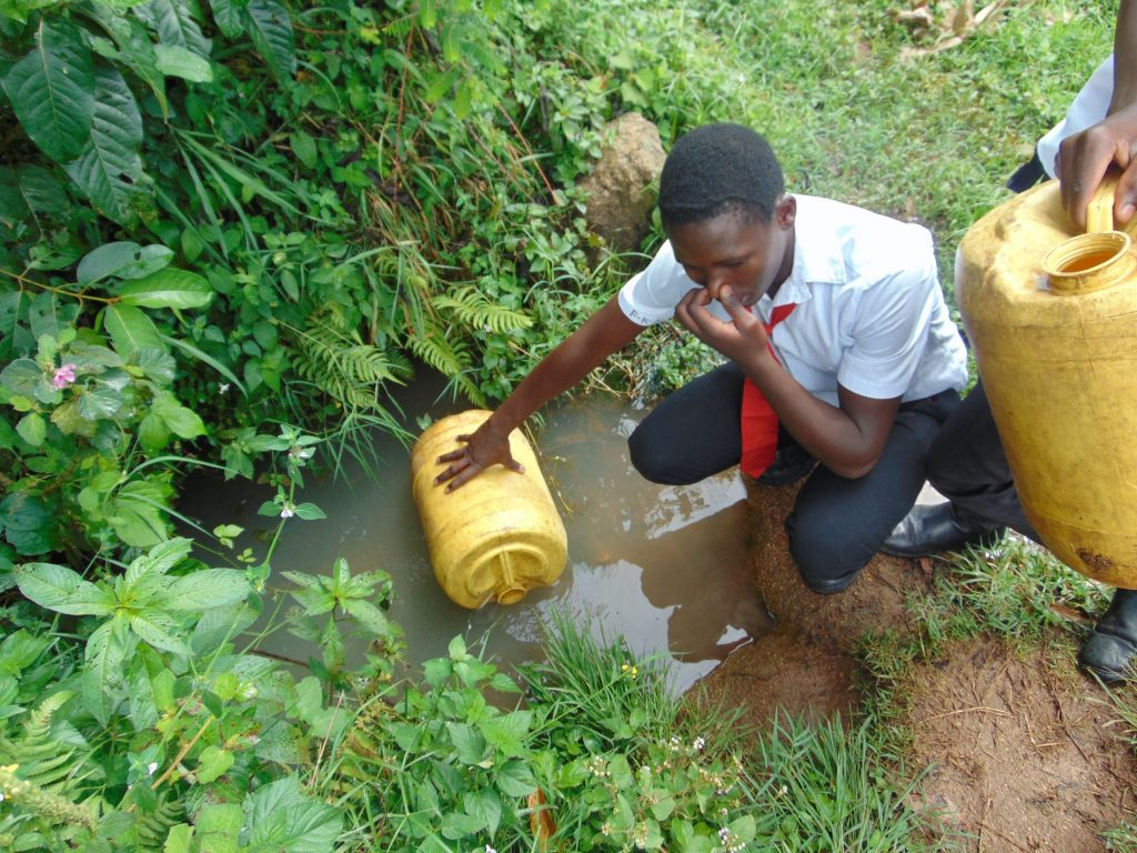 The Water Project : 17-kenya20110-student-holding-nose-against-waters-smell-3