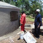 The Water Project: Ematiha Secondary School -  Inscribing The Rain Tank