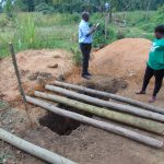 The Water Project: Mukangu Primary School -  Team Leader Catherine Chepkemoi Supervising Latrine Work