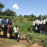 The Water Project: St. Gerald Mayuge Secondary School -  Students And Staff At The Spring