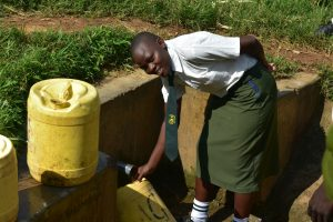 The Water Project:  Student Fetching Water At The Spring