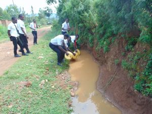 The Water Project:  Students Collecting Surface Water From Home
