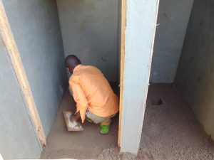 The Water Project:  Cementing Inside Of Latrines Floors