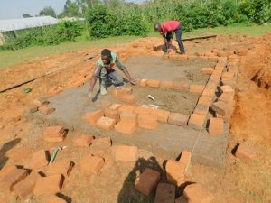 The Water Project:  Brickwork Laid Over Cement Latrine Foundation