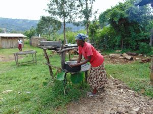 The Water Project:  School Cook Washing Utensils At The Dishrack