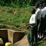 The Water Project: ACK St. Peter's Khabakaya Secondary School -  Students Waiting In Line At The Spring