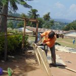 The Water Project: Musasa Primary School -  Working On Latrine Doors