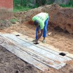 The Water Project: Ematiha Secondary School -  Cutting Holes For Latrine Floors
