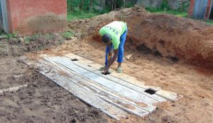 The Water Project:  Cutting Holes For Latrine Floors