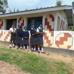 The Water Project: Friends Mixed Secondary School Lwombei -  Girls At The Shared Latrine Block