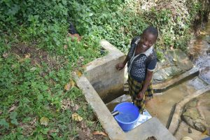 The Water Project:  Smiling Fetching Water