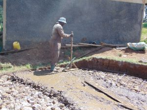 The Water Project:  Adding Concrete To Rain Tank Foundation