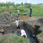 The Water Project: Chegulo Community, Sembeya Spring -  Foundation Setting