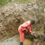 The Water Project: Hirumbi Community, Khalembi Spring -  Diverting Water