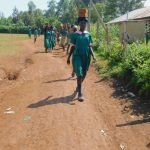 The Water Project: Shinyikha Primary School -  Students Deliver Bricks