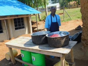 The Water Project:  School Cook Behind Dishrack