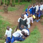 The Water Project: Mutiva Primary School -  Students Line Up To Fetch Water At The Spring