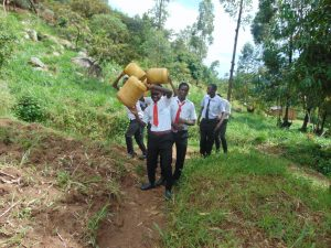 The Water Project:  Students Hauling Water