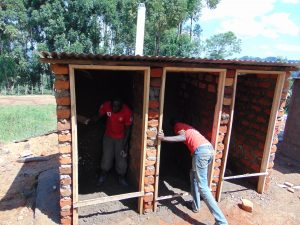The Water Project:  Working Inside Latrine Walls