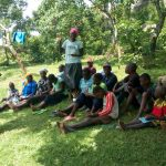 The Water Project: Chegulo Community, Sembeya Spring -  Community Member Answers A Question