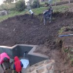 The Water Project: Bungaya Community, Charles Khainga Spring -  Soil Layer Backfilling