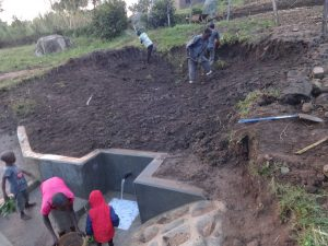 The Water Project:  Soil Layer Backfilling