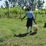 The Water Project: St. Peter's Khaunga Secondary School -  Student Carrying Water