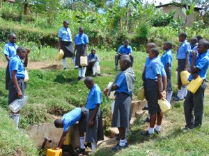 The Water Project:  Students Line Up To Collect Water